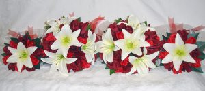 White lillies red roses